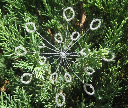 Add multiple snowflakes all over an evergreen tree to decorate for Christmas!